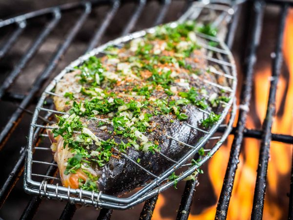 29754386 – grilled fish with spices on fire