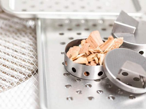 Stainless steel smoking pucks with smoking apple chips.