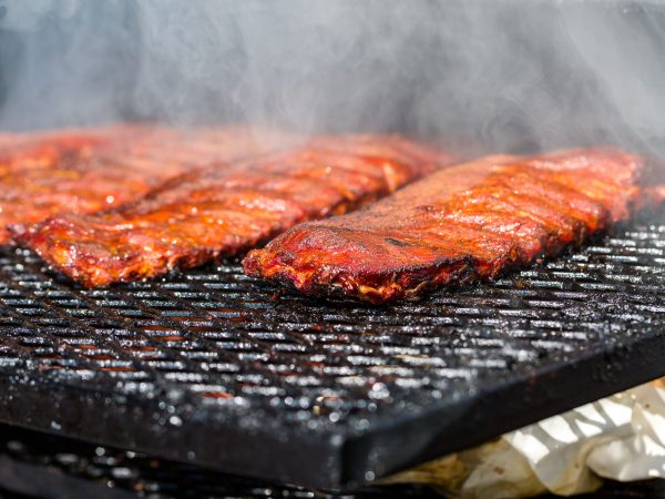 Baby back ribs prepared in smoker.
